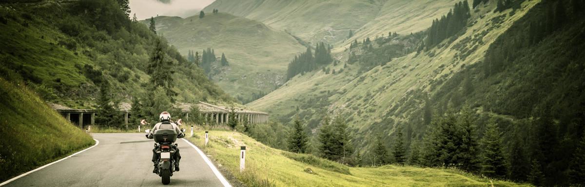 [img] Motorcyclist on mountainous highway