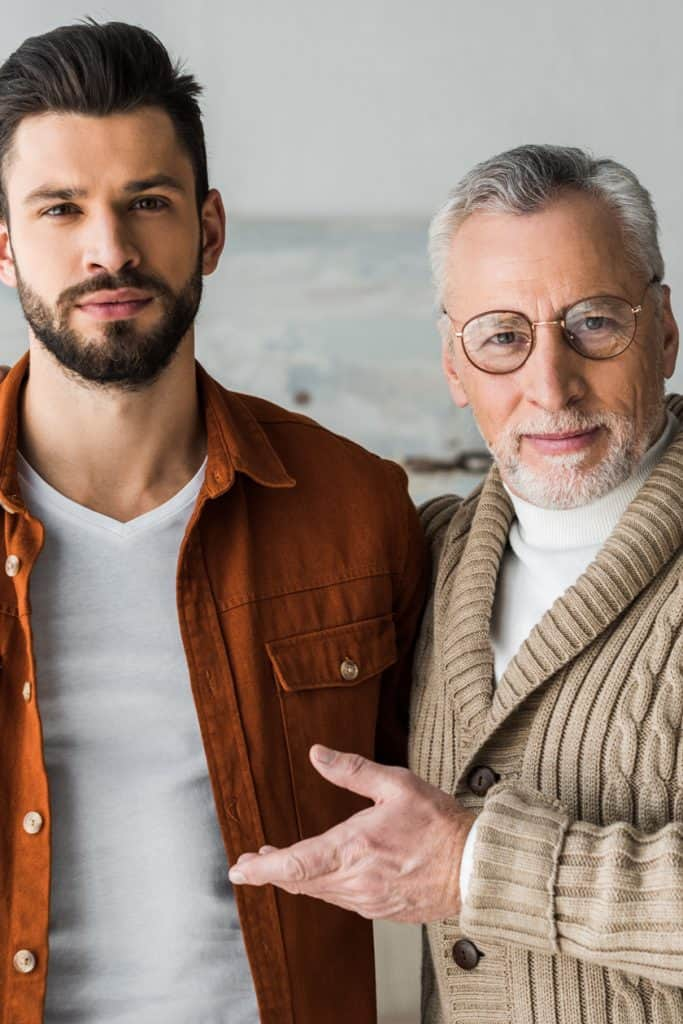 [img] Senior father gesturing near handsome bearded son