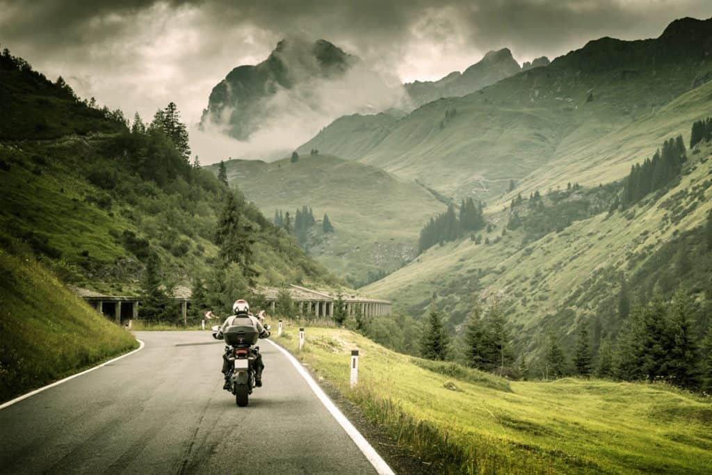 [img] Motorcyclist on mountainous highway